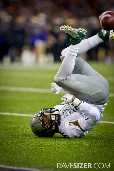 LaMichael James flips over after dropping a pass.