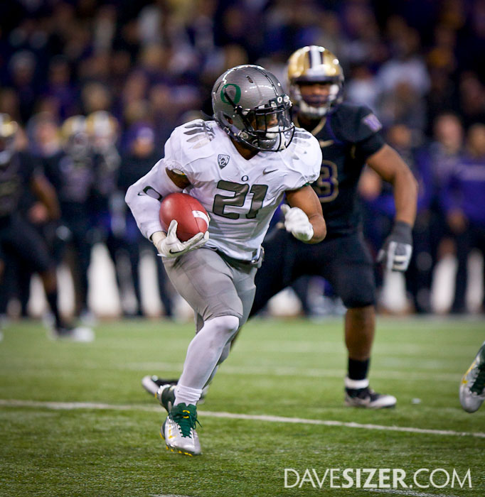 LaMichael James looks to bust through the Huskies Defense.