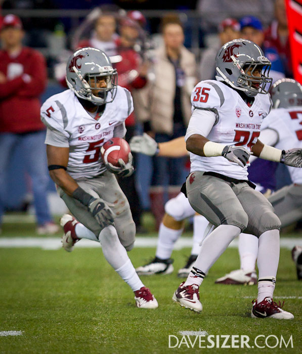 WSU RB Rickey Galvin looks for a hole in the Husky defense.