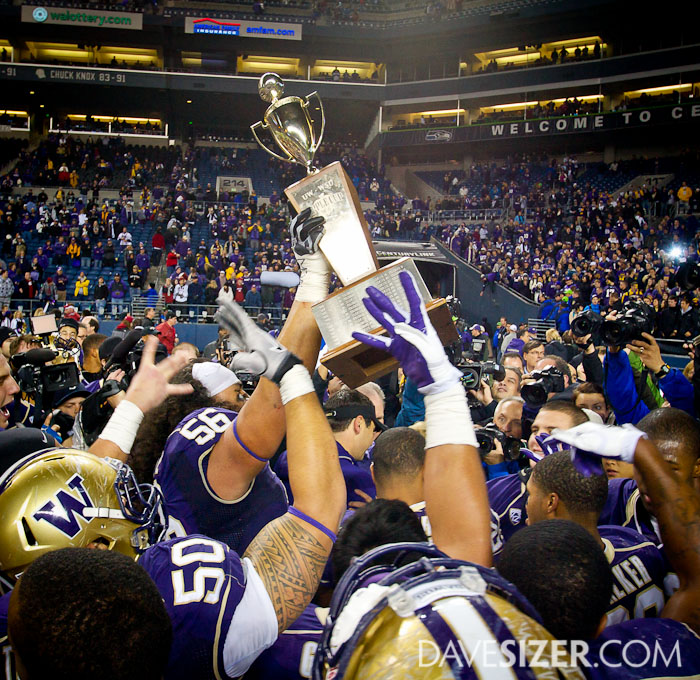 The Huskies hold the trophy high after their victory.