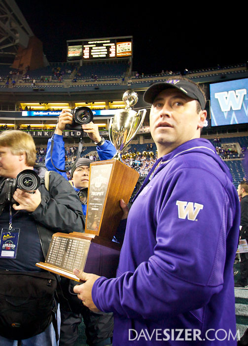 Coach Sarkisian with the Apple Cup trophy.
