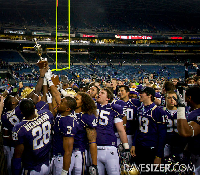 The Huskies acknowledge the crowd with the trophy.