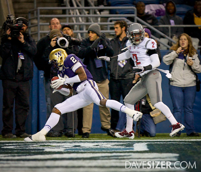 Husky WR Kasen Williams hauls in a touchdown pass in the first quarter.