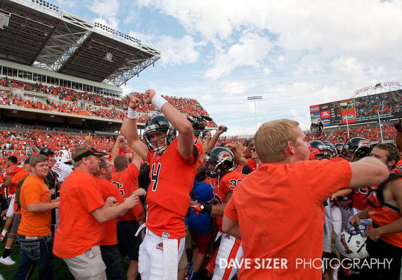 Sean Mannion (#4) celebrates with the crowd that stormed the field after the Beavers upset #13 Wisconson