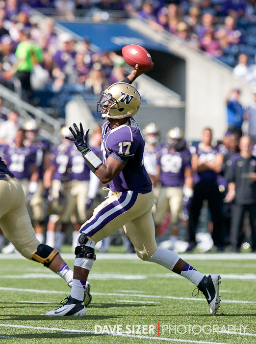 Keith Price unloads a pass in the first half. He only played about held of the game and still had 181 yards and 3 TD.