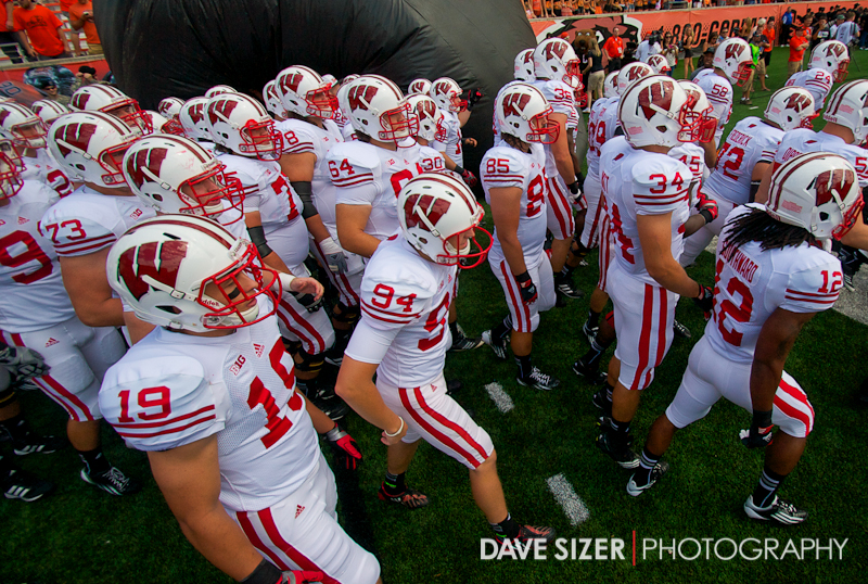 The Badgers take the field.