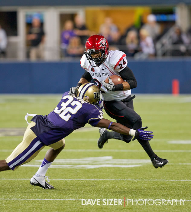 SDSU's Colin Lockett tries to shake Tre Watson.
