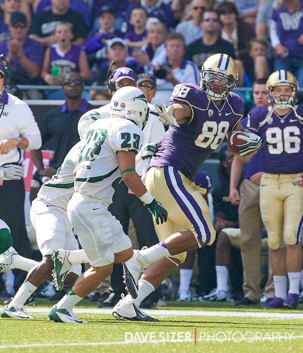 Austin Seferian-Jenkins puts out a stiff-arm to keep the Viking defenders away.