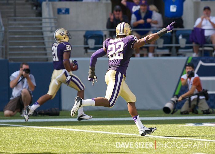Josh Shirley (22) points to the end zone as Marcus Peters (21) returns an interception for a TD.