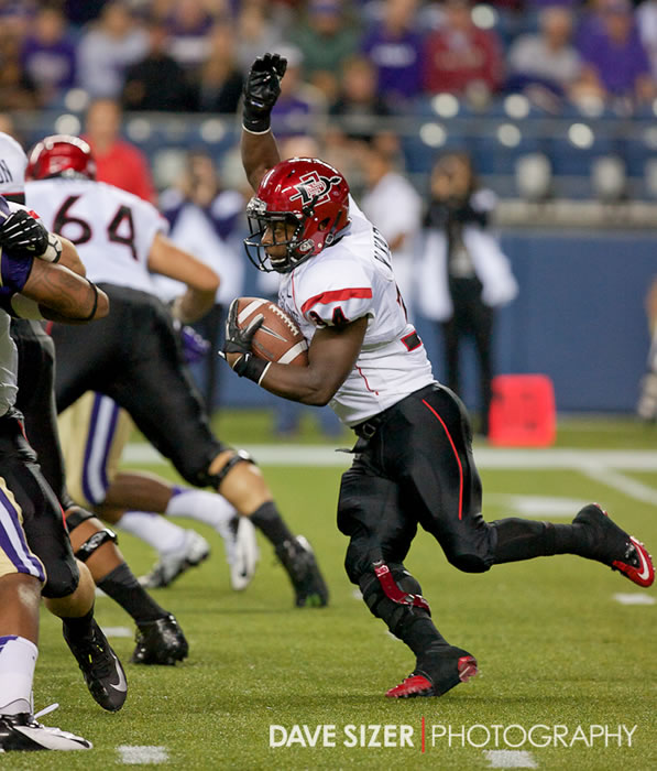 Aztec RB Dwayne Garrett cuts through the defense.