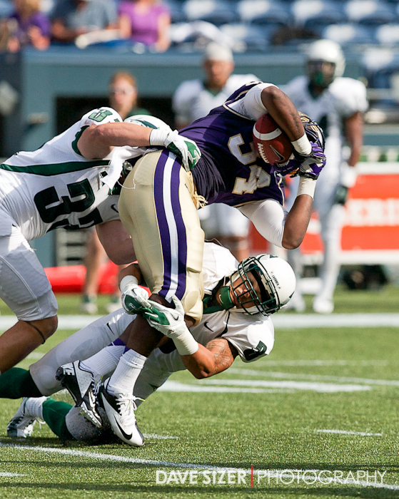 Dezden Petty is brought down by Viking defenders.