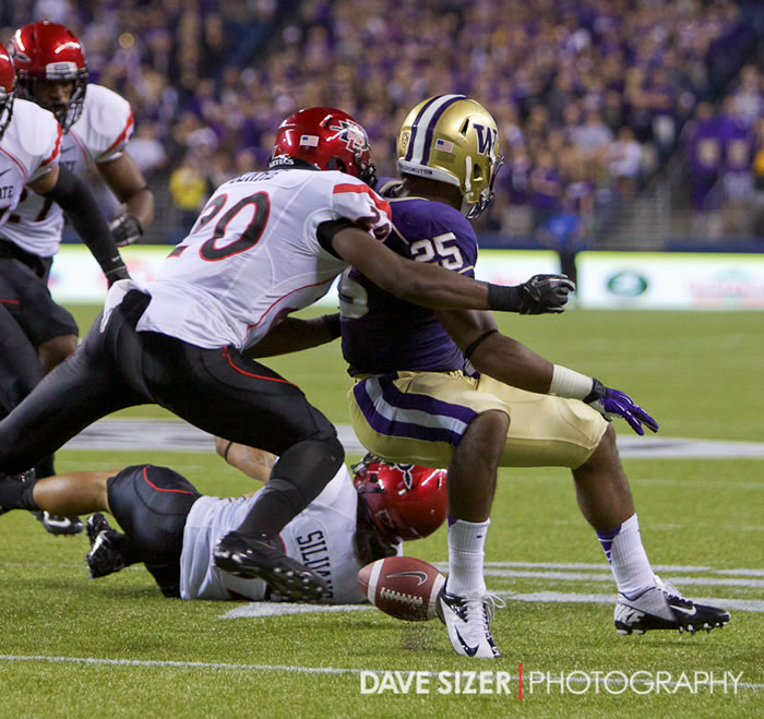 Bishop Sankey fumbles the ball lat in a drive that was recovered by the Aztecs.