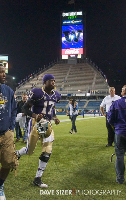 A victorious Keith Price jogs off the field after the game.