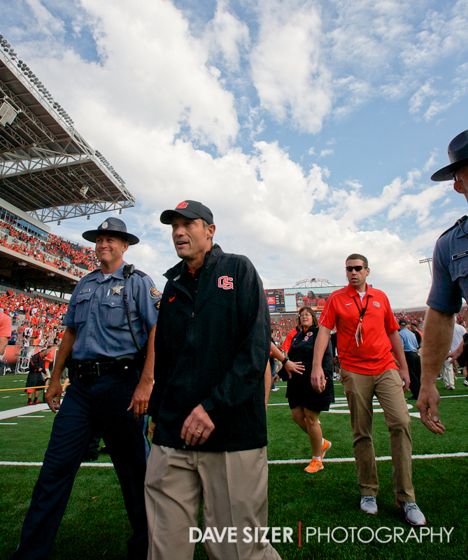 OSU Head Coach Mike Riley Walks off the field after the upset win.
