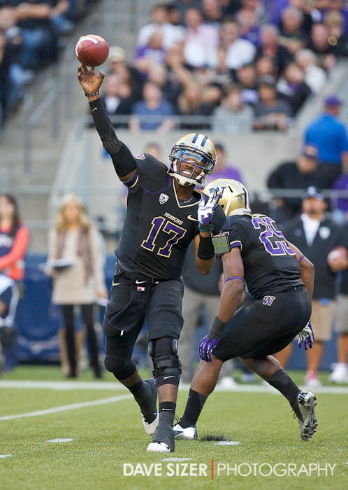 Husky QB Keith Price unloads a pass.