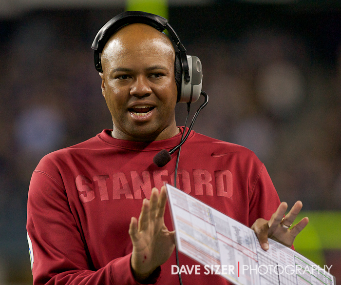 Coach David Shaw talks to the officials about a push-off call.