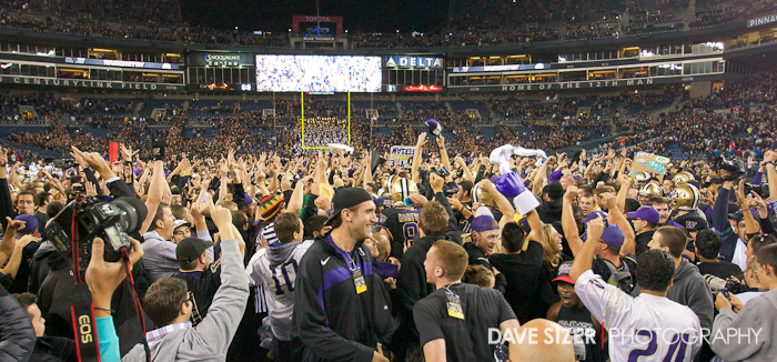 The crowd storms the field after the Huskies knock off the No. 8 team in the country (in the center, front is former Husky and current Philadelphia 76er B-Ball player Spencer Hawes).