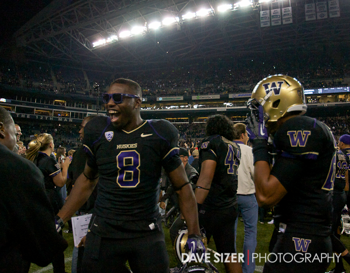 Husky WR Kevin Smith sports some shades and celebrates with the crowd.