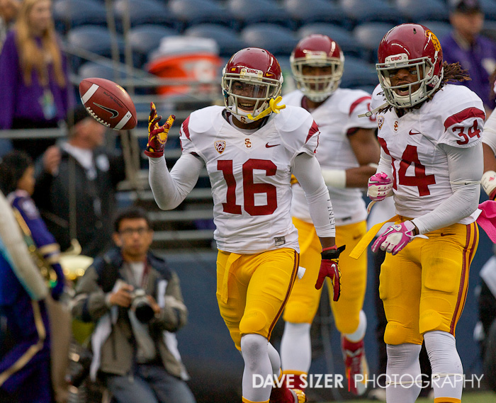USC CB Anthony Brown flips the ball to the official after plucking a punt and returning it for a touchdown.