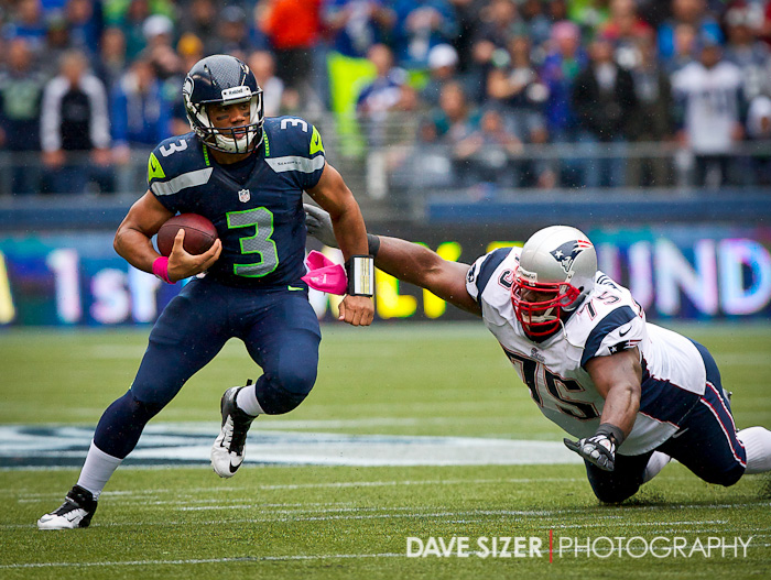 Russell Wilson scrambles to avoid Vince Wilfork.