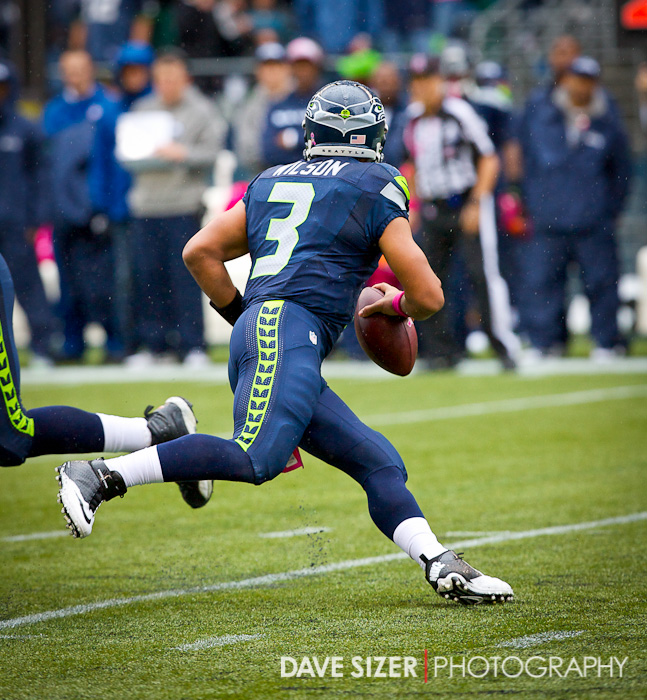 Russell Wilson scrambles outside for some yards.