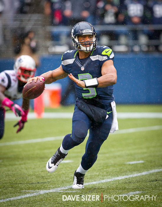Russell Wilson makes a throw on the run.