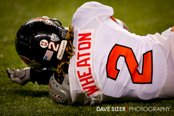 OSU's Marcus Wheaton lays motionless on the ground after a big hit.
