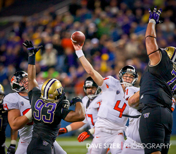 Sean Mannion gets a pass off through the outstretched arms of Husky defenders.