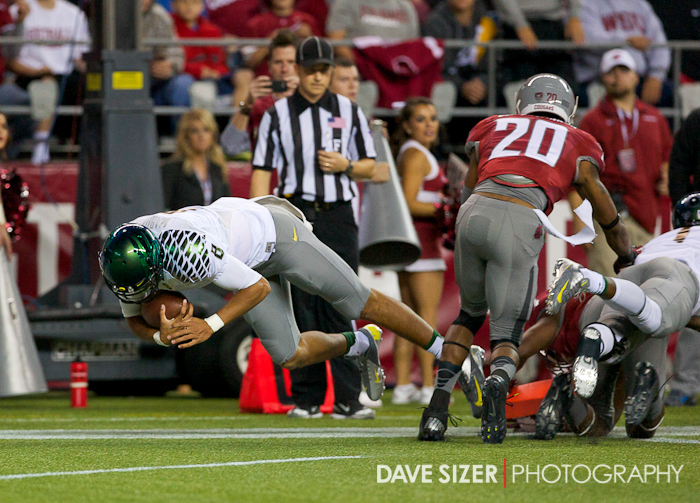 Oregon QB Marcus Mariota leaps over the pilon for a Ducks Touchdown.