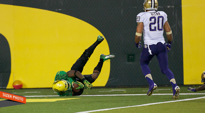 Oregon's Josh Huff lands in the end zone after diving in for a score.