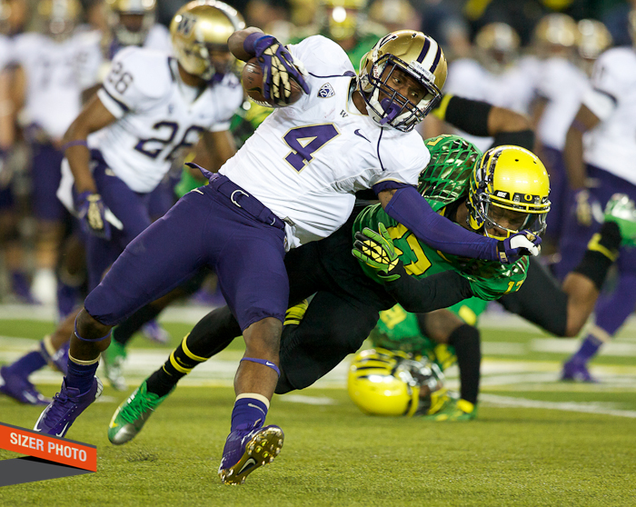 Huskies WR Jaydon Mickens was penalized on this kick return for grabbing the face mask of Troy Hill.
