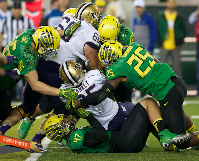Huskies RB Bishop Sankey gets swallowed up by the Duck D.
