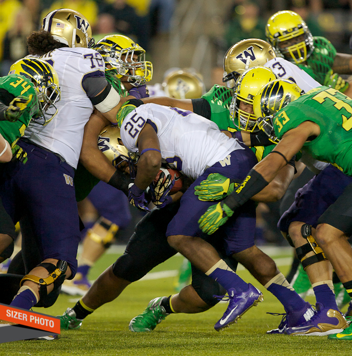 The Oregon defense gangs up on Bishop Sankey.