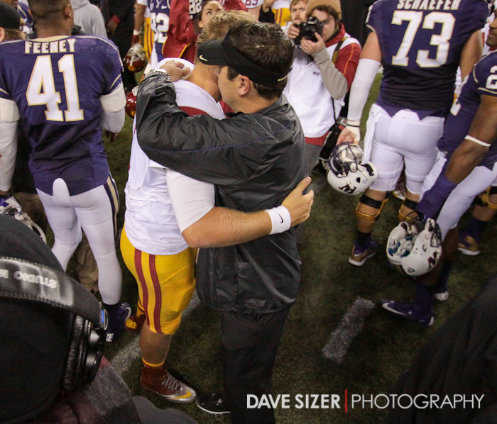 Coach Sark congratulates Trojan QB Matt Barkley after the game.