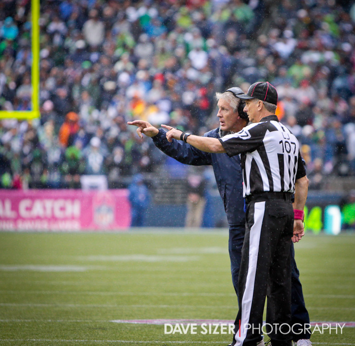 Head Coach Pete Carroll has a discussion with the Line Judge.