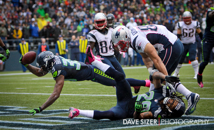 Brandon Browner almost makes an interception breaking up this pass.