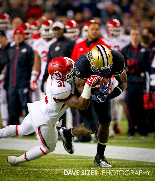 UW's Kasen Williams is dragged down by Victor Spikes.