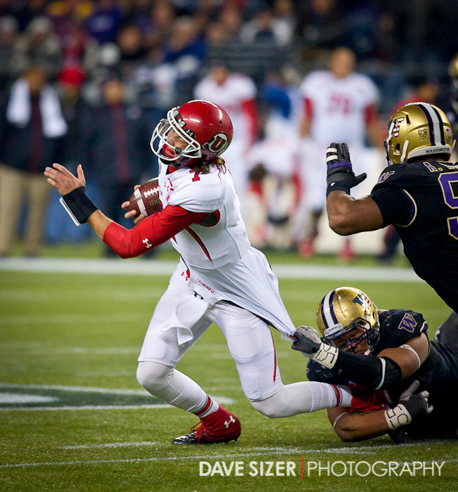 Travis Wilson gets hauled down by Danny Shelton.