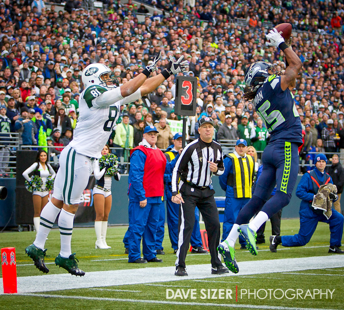 Richard Sherman leaps in front of Dustin Keller for an interception.