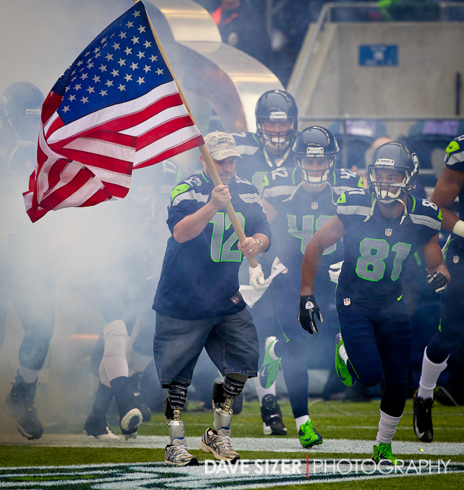 United States Army Sgt. Erin M. Schaefer who lost both of his legs in Afghanistan lead the Seahawks out onto the field as part of the Veterans Day tribute at the stadium and across the NFL.