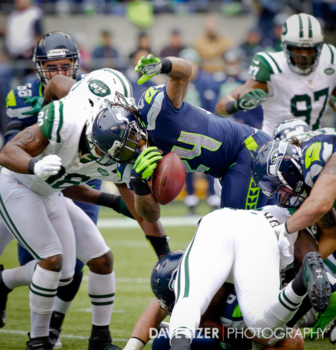 Marshawn Lynch coughs up the ball in the 2nd quarter.