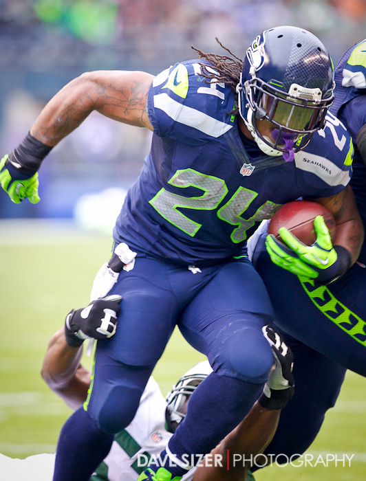 Marshawn Lynch powers through the line.