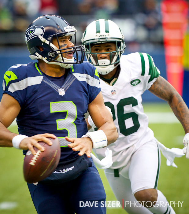 Jets' CB Ellis Lankster bears down on Russell Wilson.