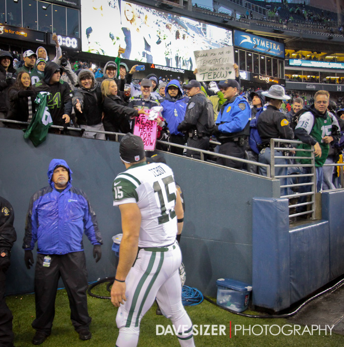 Tim Tebow walks past his section of fans on the way to the locker room.