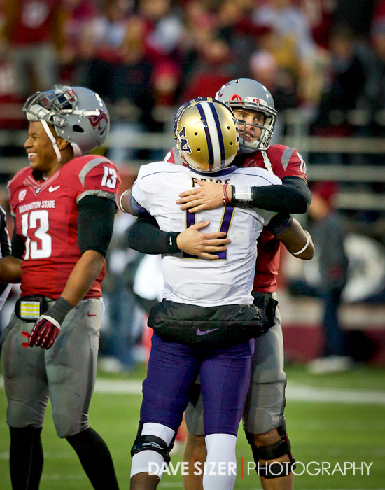 The two QBs congratulate each other during the coin toss for overtime.