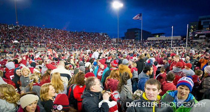 The crowd swarms the field.