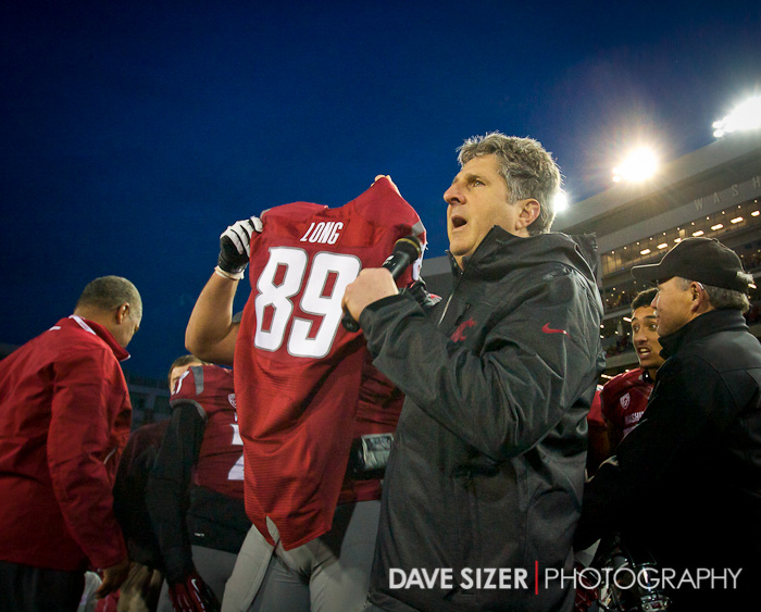 Leach hold the jersey of Senior Travis Long who was injured and had to sit out his first game of his career after starting for the past 4 years. The team dedicated the game to him.