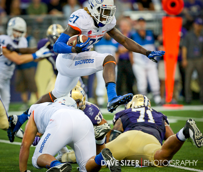 BSU's Jay Ajayi leaps over Washington defenders for a gain.
