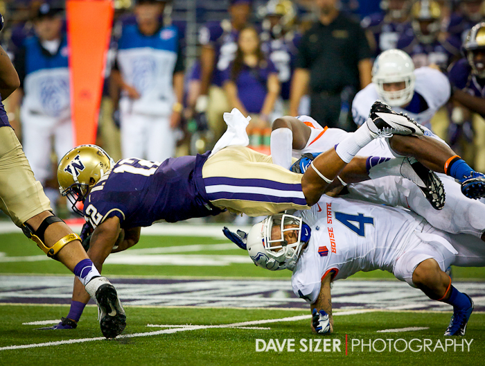 Freshman RB Dwayne Washington plows over Darian Thompson for a few more yards.