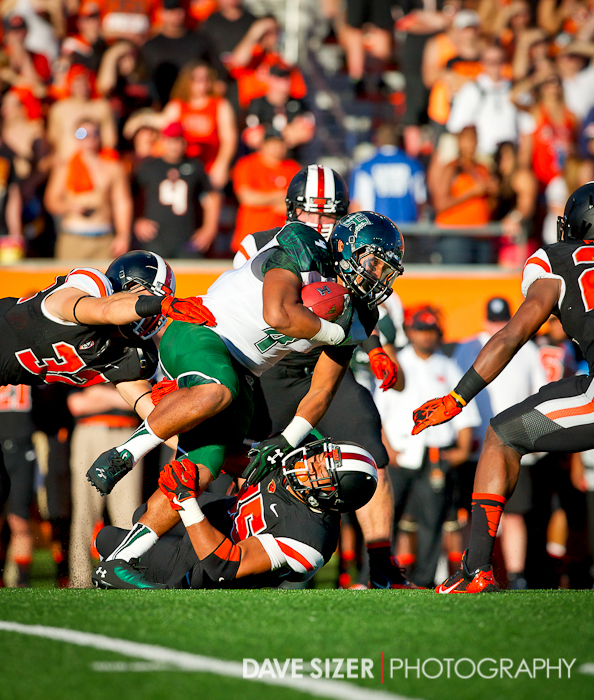 Steven Lakalaka powers over the OSU defense for yardage.